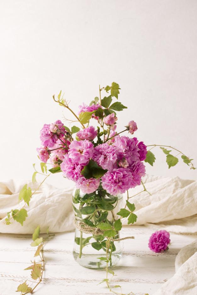 bouquet-of-flowers-in-vase-on-table_23-2148029250.jpg