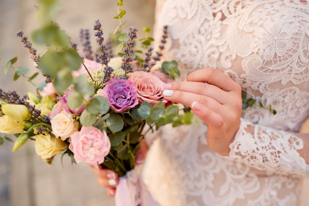 close-up-of-pink-and-violet-wedding-bouquet-in-bride-s-hands_8353-8656.jpg