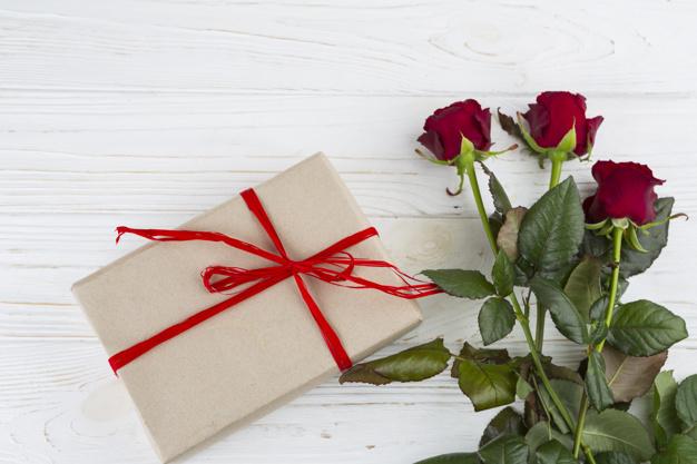 present-box-near-fresh-flowers_23-2147999688.jpg