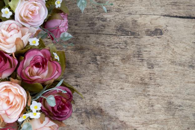 rose-flowers-on-rustic-wooden-background-copy-space_1421-597.jpg