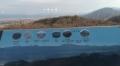 4 大峰山系の看板とその奥に大峰山 大系